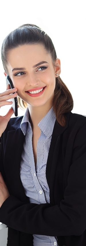 Beautiful smiling business woman speaking on mobile phone